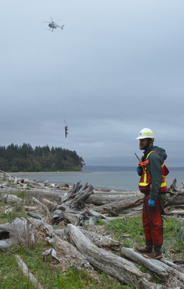 A helicopter helps remove creosote from the Doe Kag Wats estuary in Kitsap County. DNR Photo